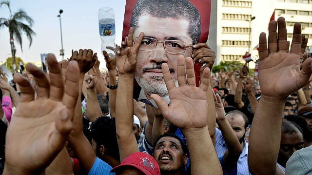 U.S. defers judgment on Morsy ouster