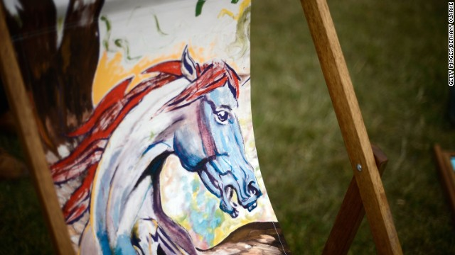 "Rolling Stones star Ronnie Wood had his painting of Teta the Horse replicated on deck chairs in a London Park in a bid to reproduce his ""Pegasus"" painting."