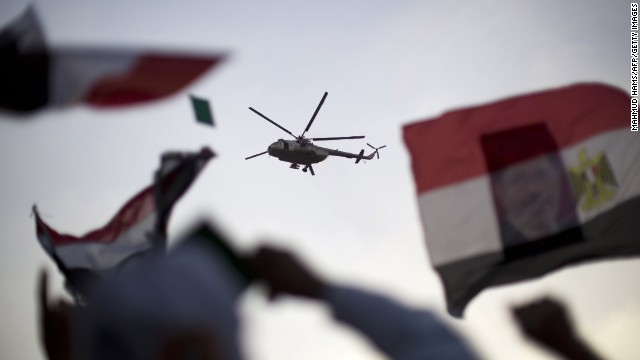 An Egyptian military helicopter hovers over supporters of the Muslim Brotherhood and deposed President Mohamed Morsy in Cairo on July 5.