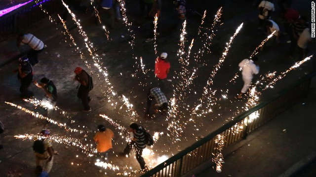 Supporters and opponents of Morsy clash in Cairo on Friday, July 5.
