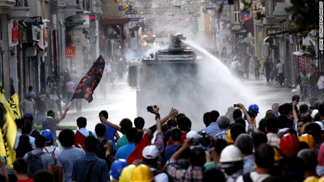 Turkish riot police fire a water cannon at protestors during an anti-government protest at Taksim Square on Saturday.