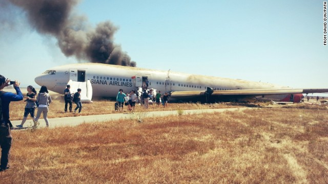 "David Eun, a passenger on Asiana Airlines Flight 214, posted this image to Path.com along with the message, ""I just crash landed at SFO. Tail ripped off. Most everyone seems fine, I'm ok. Surreal..."" It was one of the first photographs taken after the crash."