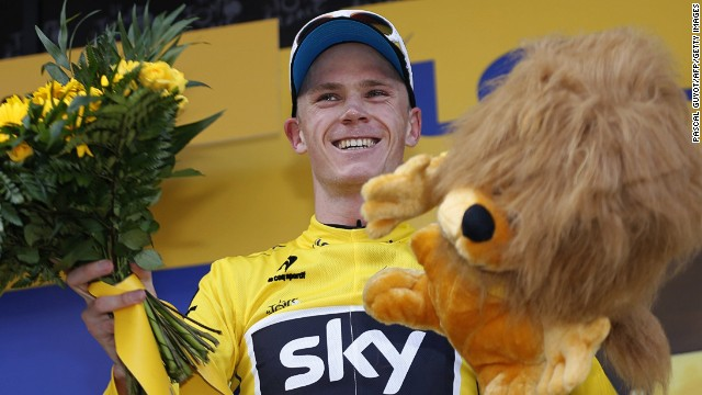 Chris Froome celebrates on the podium after the 195 km eighth stage of the 100th edition of the Tour de France.