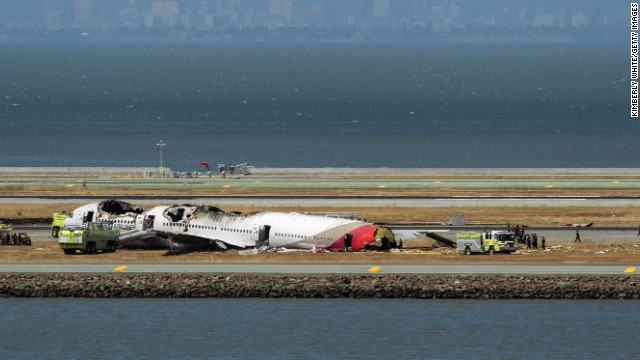 Crews surround the remains of the plane on July 6.