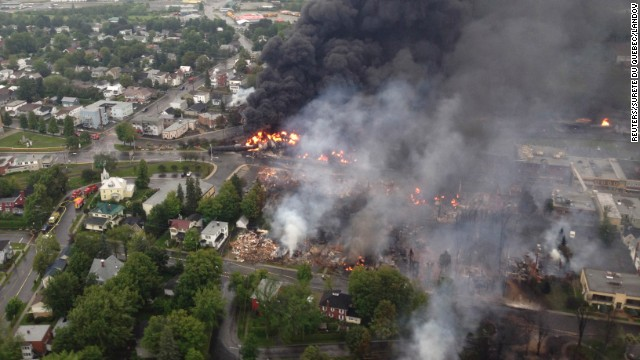 Smoke billows from a fire at the site of a train derailment on Saturday, July 6.