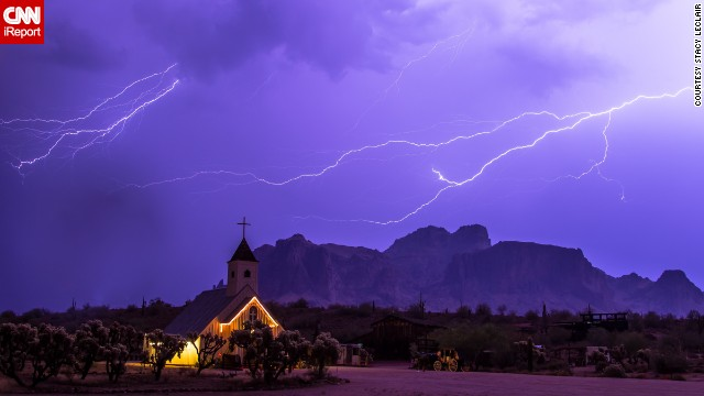 "Storm chaser <a href='http://ireport.cnn.com/docs/DOC-1001516'>Stacy LeClair</a> got this shot during a severe storm that swept through Apache Junction, Arizona, on July 7. ""The Superstition Mountains are a favorite landmark in Arizona, and the church offered a unique background for showing how powerful nature can be,"" she said."