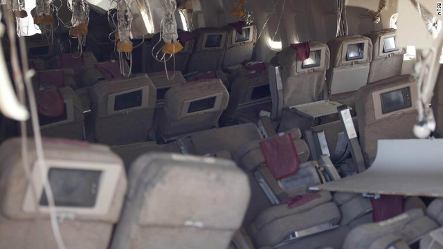 A photo showing the damaged interior of the aircraft was released by the NTSB on July 7. The flight carrying 291 passengers and 16 crew took off from Shanghai and stopped in Seoul before heading to San Francisco.