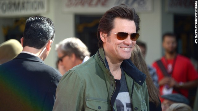 Jim Carrey, children's author, still 'Dumb'