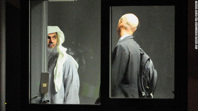 Radical cleric Abu Qatada prepares to board a plane which will take him to Jordan, after he was deported from the UK to face terrorism charges in his home country, on July 7 in London, England.