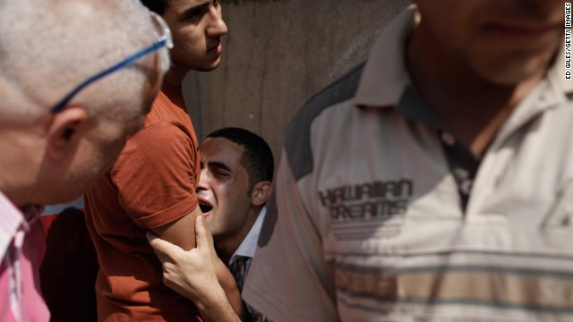 A man reacts after seeing the body of a family member at the Liltaqmeen al-Sahy Hospital in Cairo, Egypt, allegedly killed during a sit-in supporting deposed president Mohamed Morsy in front of the Republican Guard on Monday, July 8. <a href='http://www.cnn.com/2013/06/29/middleeast/gallery/egypt-protest/index.html'>See photos of protests that erupted before Morsy was ousted.</a>