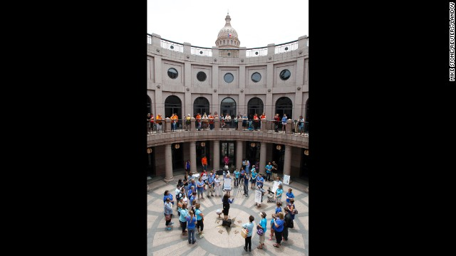 Anti-abortion protesters gather on the ground floor of the state Capitol as abortion rights protesters gather on the balcony of the outdoor rotunda July 8.