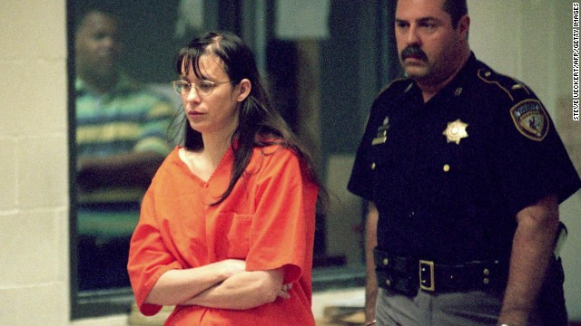 "Yates is escorted into court on June 22, 2001, in Houston. Her trial began on February 18, 2002. The prosecution's expert witness, psychiatrist Park Dietz, testified that Yates got the idea to drown her children from an episode of ""Law & Order."" However, the show's producers later said that no such episode aired."
