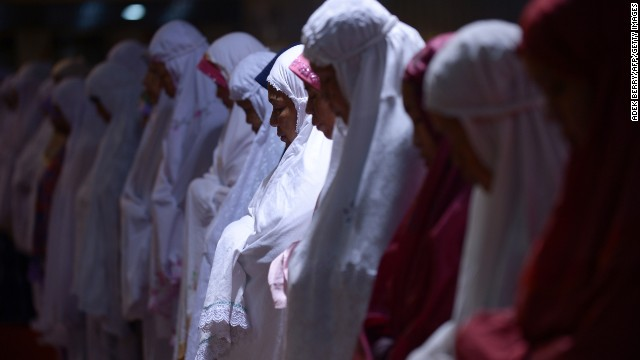 Women hold prayers on the first night of Ramadan in Jakarta on July 9.
