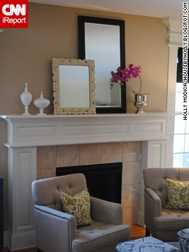<a href='http://ireport.cnn.com/docs/DOC-1000852'>Holly Modica</a> of Middletown, Connecticut, used mirrors on her mantel to add whimsy and interest and to highlight the room's height.