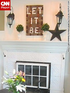 <a href='http://ireport.cnn.com/docs/DOC-1001370'>Holly Browning</a> of Midlothian, Virginia, transformed her fireplace with tin ceiling tiles, molding, a vintage window firescreen and an upcycled sign made from an old garden barrel.