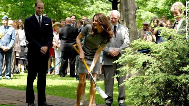 During their visit to Canada, Catherine shovels soil as Prince William watches on July 2, 2011 during a tree-planting ceremony in Ottawa.