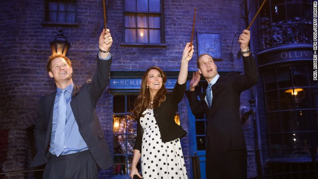 Prince Harry and the royal couple make magic on the set used to depict Diagon Alley in the Harry Potter films during the inauguration of Warner Bros. Studios Leavesden in London on April 26.