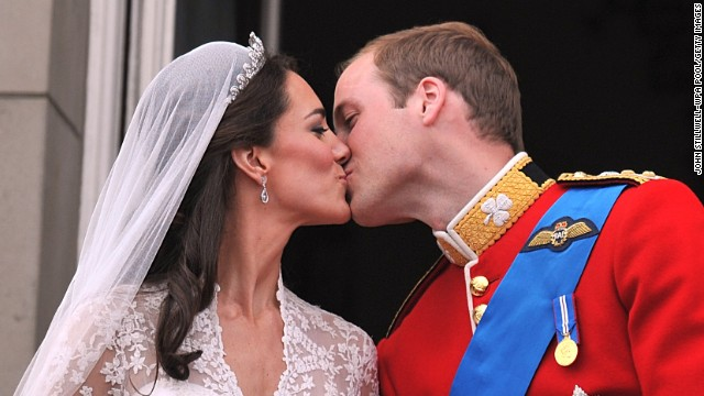 Their Royal Highnesses Prince William, Duke of Cambridge and Catherine, Duchess of Cambridge kiss on the balcony at Buckingham Palace after their wedding ceremony on April 29, 2011, in London.