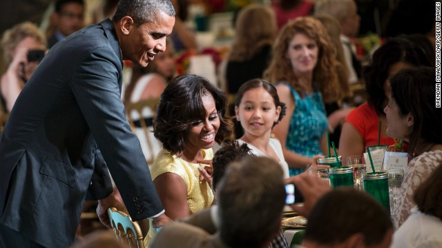 "President Barack Obama and first lady Michelle Obama chat with guests during the second kids' ""state dinner"" on Tuesday, July 9, at the White House. Fifty-four children, along with their parents and guardians, attended as winners of the Healthy Lunchtime Challenge."