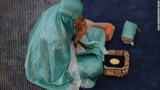 An Indonesian woman prays at a mosque in Jakarta on July 10.