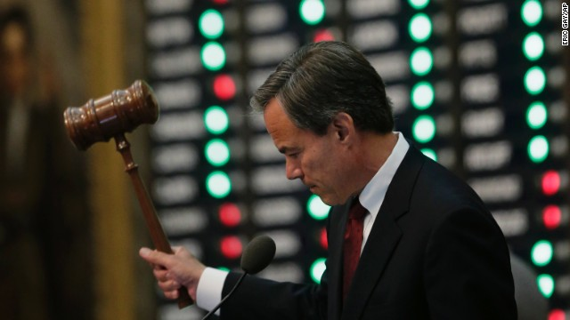 Texas Speaker of the House Joe Straus strikes the gavel after a provisional vote on the abortion measure passed July 9. A lawsuit, filed by Planned Parenthood on behalf of more than a dozen women's health care providers across Texas, alleged that the new abortion limits violate the constitutional rights of women and put unreasonable demands on doctors who perform abortions.