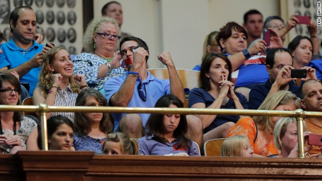 Supporters of the abortion limits react in the gallery of the Texas House after the measure was provisionally approved July 9. The measure seeks to ban abortions past 20 weeks of gestation, mandate abortion clinics to become ambulatory surgical centers, and tighten usage guidelines for the drug RU486. It would also require doctors who perform abortions to have admitting privileges at a hospital within 30 miles of the clinic where they're providing abortion services.