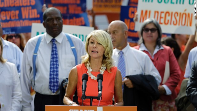 State Sen. Wendy Davis speaks at a news conference outside the state Capitol as the Texas House prepares to begin debate on the bill in July. In late June, Davis blocked the bill with a filibuster, talking for more than 10 hours and running out the clock on the regular legislative session.