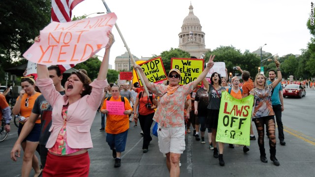 Abortion rights activists march from the Texas Capitol on July 8.