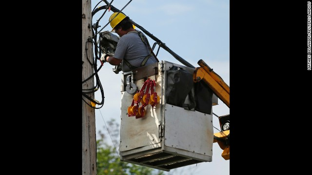 A worker reconnects wires on July 9.