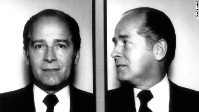 "James ""Whitey"" Bulger, the reputed former head of Boston's Winter Hill Gang, evaded police for 16 years before being arrested with girlfriend Catherine Greig in Santa Monica, California, in 2011. Seen here in a 1984 FBI photo, he is facing trial for racketeering, extortion and 19 counts of murder."