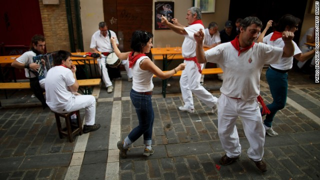 People dance while musicians play traditional music from the Basque country after lunch during the San Fermin festival on July 10.