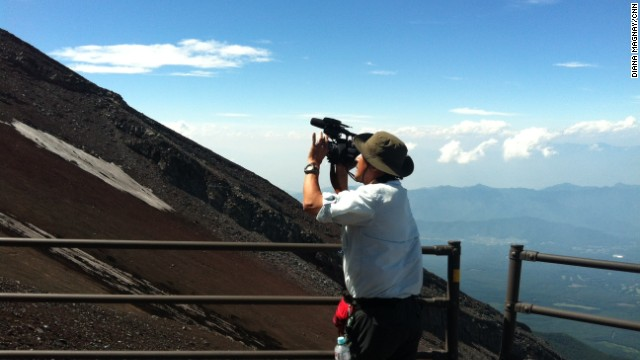 Our cameraman, Hide, gives some perspective on how steep the slopes of Mount Fuji are.
