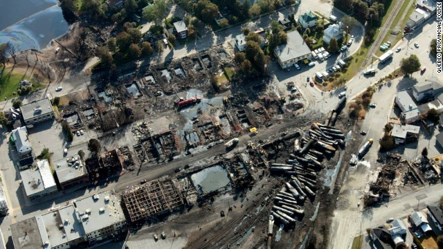 Most of the 73-car train derailed in the center of Lac-Megantic early Saturday, and tank cars full of oil exploded and burned. Quebec provincial authorities have found 20 bodies, and 30 more are missing