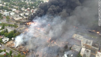 Quebec Provincial Police (Sûreté du Québec) releases a photograph taken from a helicopter of train deralment explosion aftermath in Lac-Megantic, Quebec on July 6, 2013. A train carrying flammable liquids derailed and caught fire in the small town of Lac-Megantic which is located near the U.S. border, the Franklin County Maine Sheriff's Office. More than 27 firefighting vehicles were sent from US cities in response to Lac-Megantic authorities'