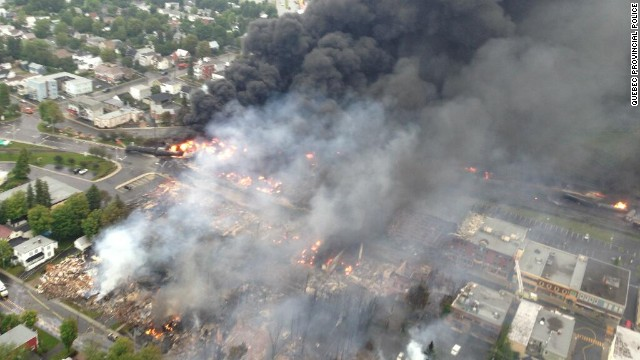 "An aerial photo from the Quebec Provincial Police shows the aftermath of a train derailment explosion in Lac-Megantic, Quebec, on Saturday, July 6. Quebec provincial authorities have found 20 bodies, and 30 more are missing and ""most probably dead."""