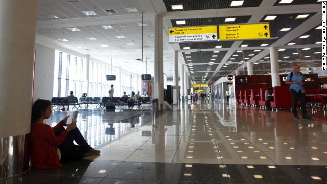 People wait in the airport's transit area. Snowden's exact location in the transit lounge has remained a mystery, and he cannot step foot on Russian soil without special visa clearance. Snowden said he is requesting asylum from Russia while awaiting safe passage to Latin America, according to a transcript issued by WikiLeaks.