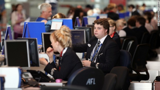 Staff check in passengers in Terminal D on July 5.