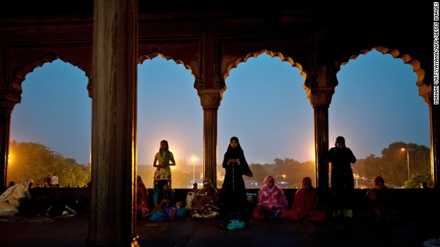 Indian Muslim women offer prayers after breaking their fast in New Delhi on July 11.