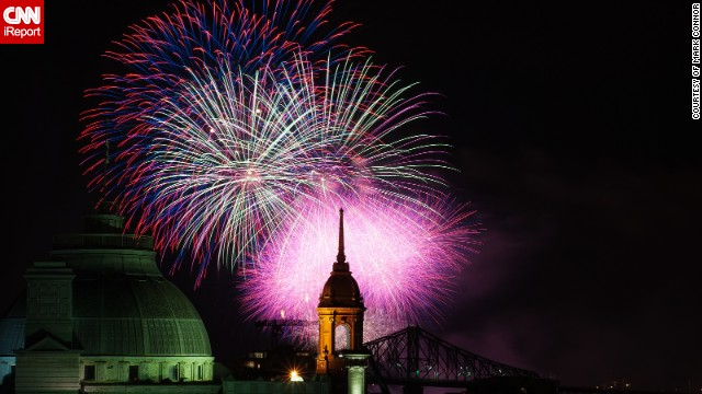 This beautifully composed photo of the Montreal skyline was taken by Mark Connor from the rooftop of a friend's apartment block during the annual Montreal fireworks competitions. The photo shows the Jacques Cartier Bridge, the Old Palace de Justice and the old Town Hall.