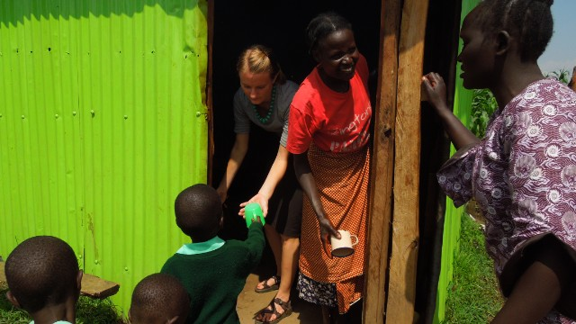 Faith Maus, a 2011-2012 Global Health Corps Fellow, with members of Daylight Center, a school and community outreach facility in Kapenguria, Kenya.