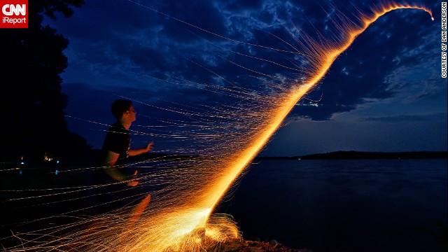 "Dan Anderson managed to capture the moment his nephew launched a bottle rocket across one of Minnesota's many lakes, Lake Kronis, during the Fourth of July in 2012. They had carefully prepared everything to take the perfect photo, counting the seconds it took from lighting the fuse to the explosion of the firework and arranging the camera on a tripod. ""We did it in one take and then ran away because the mosquitoes were eating us alive,"" he says."