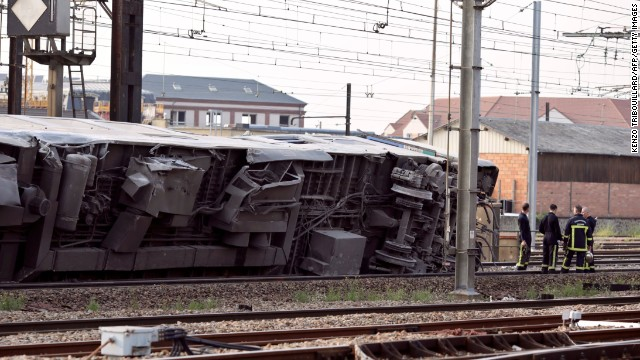 A car from the train is seen on its side after the accident on July 12.