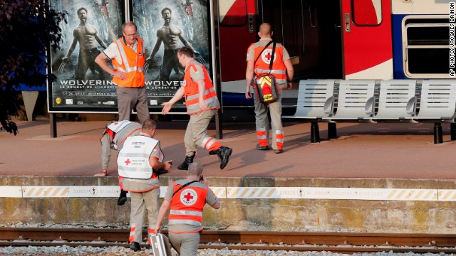 Rescue workers arrive at the Bretigny-sur-Orge station on July 12.