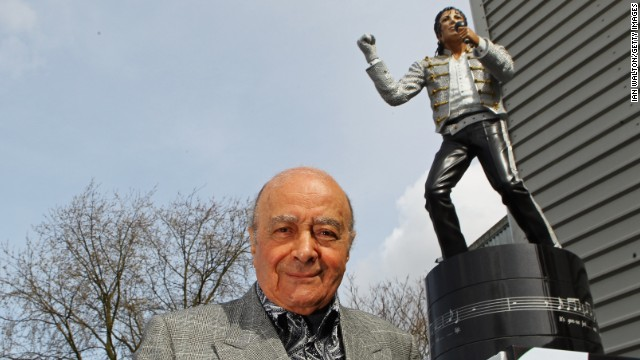 Mohamed Al Fayed, who sold Fulham on Friday, stands near a statue of Michael Jackson outside Fulham's stadium in 2011.