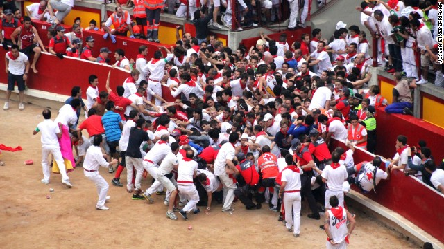 Runners clog the entrance to the bull ring in Pamplona ahead of several bulls on July 13. The resulting clash between revelers and bulls resulted in several injuries.