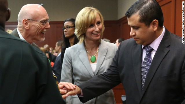 George Zimmerman is congratulated by members of his defense team, Don West and Lorna Truett, after the not guilty verdict is read on Saturday, July 13, in Sanford, Florida. A jury of six women found him not guilty in the shooting death of Trayvon Martin. View photos of the public reaction to the verdict.