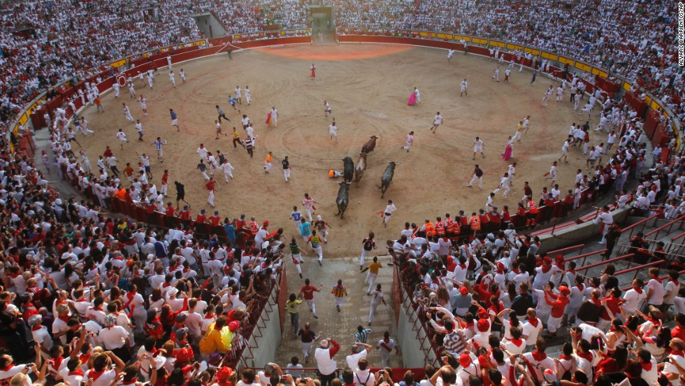 Bulls chase revelers during the final running of the bulls at the San Fermin festival in Pamplona, Spain, on Sunday, July 14. The annual festival of San Fermin involves letting the bulls loose through the historic heart of the city. The nine-day festival ends Sunday.