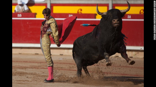 Bullfighter Juan Jose Padilla performs with a bull during the San Fermin festival on Saturday, July 13.