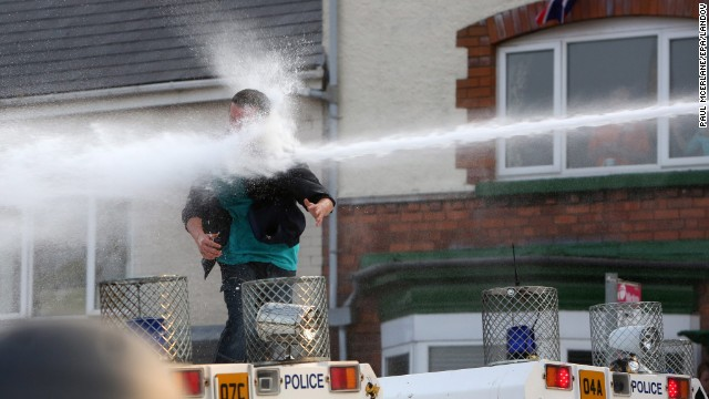 A man is hit by a water cannon in on July 12.