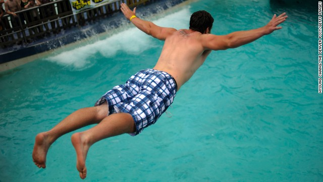 Matt Gackle belly-flops during the 15th annual Water World Belly-Flop Showdown in Denver in 2011.